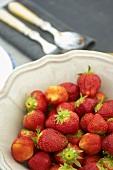 Fresh strawberries in a ceramic bowl