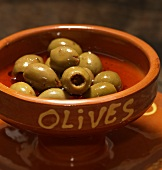 Green olives in a terracotta bowl