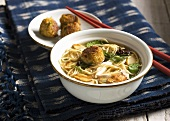 Noodle soup with crab dumplings and chicken