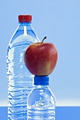 Bottles of mineral water and an Elstar apple