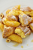 Kaiserschmarren (shredded sugared pancake from Austria) with caramelised apples and icing sugar