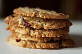 A stack of walnut and cranberry biscuits