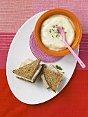 Bowl of Cauliflower Soup; Turkey Pesto Sandwich on Whole Wheat Bread