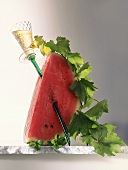 Watermelon with a wine glass and a vine
