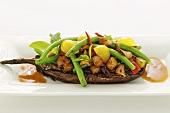 Stuffed aubergines with beans and tamarind sauce (Asia)