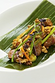 Glazed veal with walnuts and green asparagus (Asia)