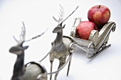 Red apples in a Christmas sleigh