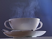 A steaming cup of soup