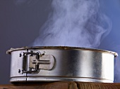 A steaming cake in a cake tin