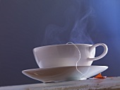 A streaming cup of tea with a tea bag