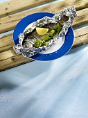 Salmon trout in aluminium foil