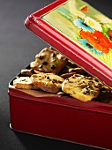 A biscuit tin filled with chocolate chip cookies