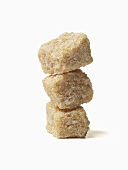 Stack of Raw Sugar Cubes; White Background