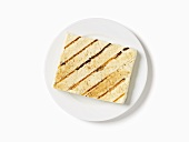 Grilled Tofu on a White Plate; White Background; From Above