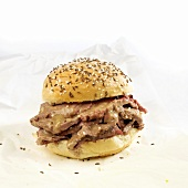 Beef on a Wick Sandwich; Beef with Horseradish on a Kaiser Roll Topped with Caraway Seeds and Salt