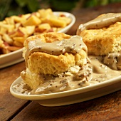 Biscuits with Sausage Gravy; On Rustic Table; Home Fries