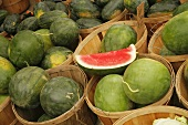 Organic Seedless Watermelon in Wooden Baskets at Farmer's Market