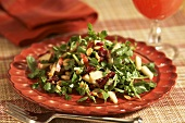 Watercress Salad with Apples, Cranberries and Peanuts; On a Plate; Fork
