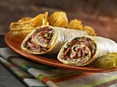 Brisket Wrap with American Cheese, Chipotle Mayonnaise and Lettuce; Chips and Pickle