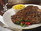Grilled Porterhouse Steak with a Side of Corn