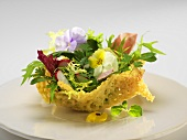 A parmesan basket filled with salad