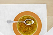Clear broth with vegetables and alphabet noodles