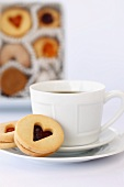 Linzer Tart Cookies with a Cup of Coffee