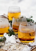 Punch glasses on birch bark and snow