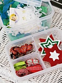 Christmas decorations and ribbons in a storage box
