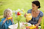 A mother and daughter dining al fresco