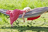 Two little girls playing with a hammock