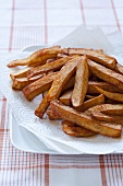 Barbecue Flavored French Fries on Paper Towel Lined Plate