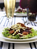 Frisee salad with walnuts, apple sticks and red beets
