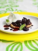 Mini cherry tart with whipped cream