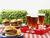 Hamburger and beer on a picnic table