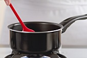 A saucepan on a gas stove