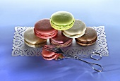 Different types of macaroons, stacked, on a cake paper placemat