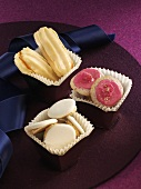 Orange cat's tongues, anise cookies and 'Himbeertaler' (cookies with raspberry icing)