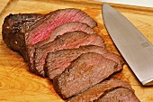 Sliced Antelope Roast on Cutting Board