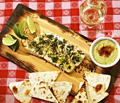 Halibut Cooked on Cedar Plank; Tortilla Chips and Avocado Dipping Sauce