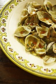 Steamed Artichoke Leaves With Harissa Dressing