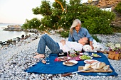 An old couple having a picnic on the beach