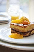 French Toast Made with Brioche; Topped with Marinated Oranges and Kumquats