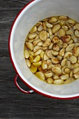 Roasted Garlic Cloves in Red Rimmed Pot