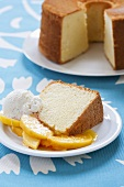Slice of Chiffon Cake with Peaches and Ice Cream; Whole Cake in Background