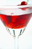 A glass of redcurrant liqueur (close-up)