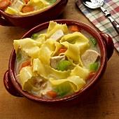 Chicken Noodle Soup Made with Wide Egg Noodles; In a Bowl