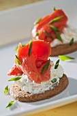 Smoked salmon with cream cheese and chives on a cracker