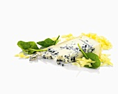 Blue cheese, grated cheese and baisl