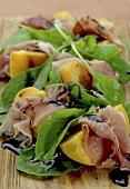 Peaches wrapped in prociutto with rocket and balsamic vinegar